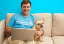 Blue Summit Supplies founder with dog and laptop