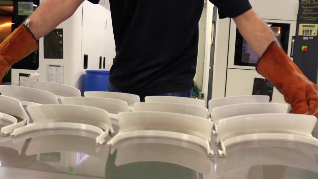 Boeing employees in Huntsville 3D printing reusable face shields