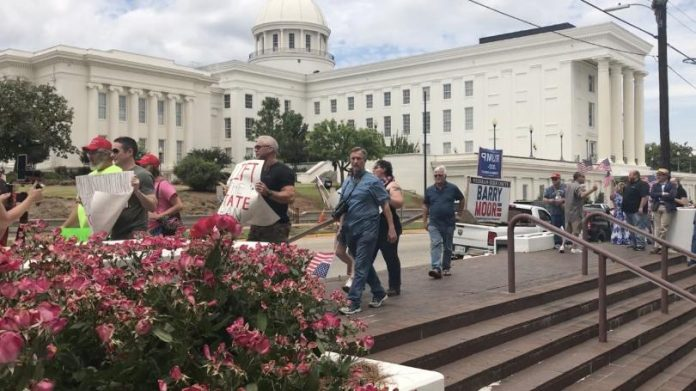 About 60 protesters outside capitol 'demand' reopening all businesses