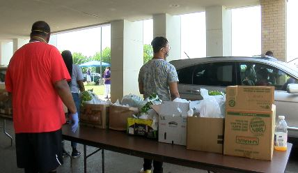 Local church passes out fresh food to struggling families