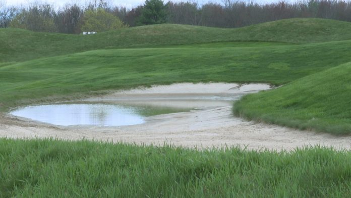 People enjoy golf courses reopening, rains delay start for other businesses