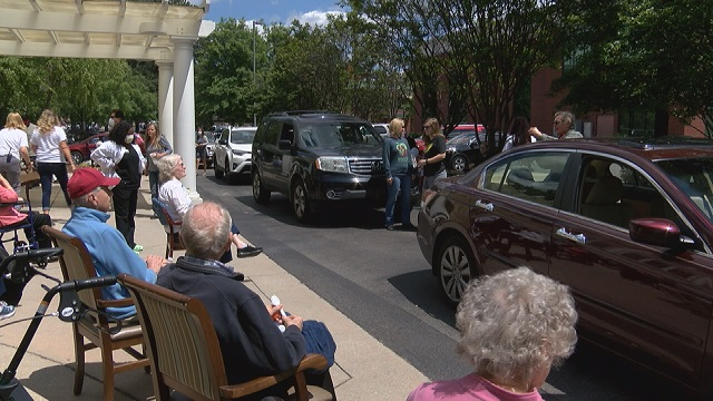 Huntsville assisted living community holds Mother's day parade for families