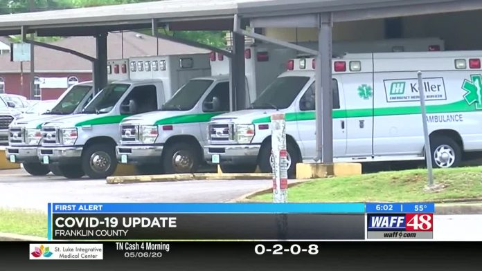 Hospital staff discusses coronavirus numbers in the Shoals