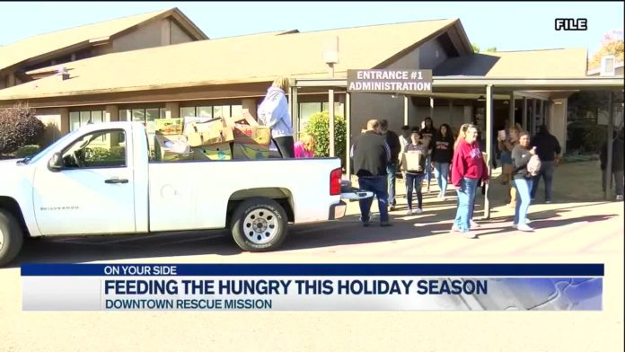 Leaders with Downtown Rescue Mission prepare to feed the homeless over the holiday