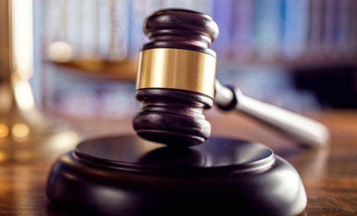 Birmingham man pleads guilty to plundering memorial fund for slain Huntsville officer