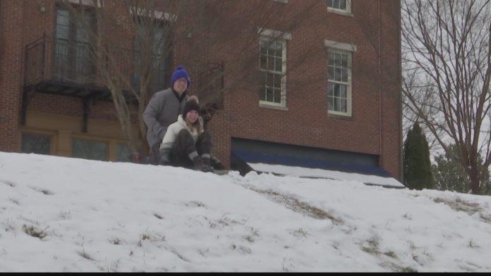 Huntsville couple goes sledding during Alabama's snow day